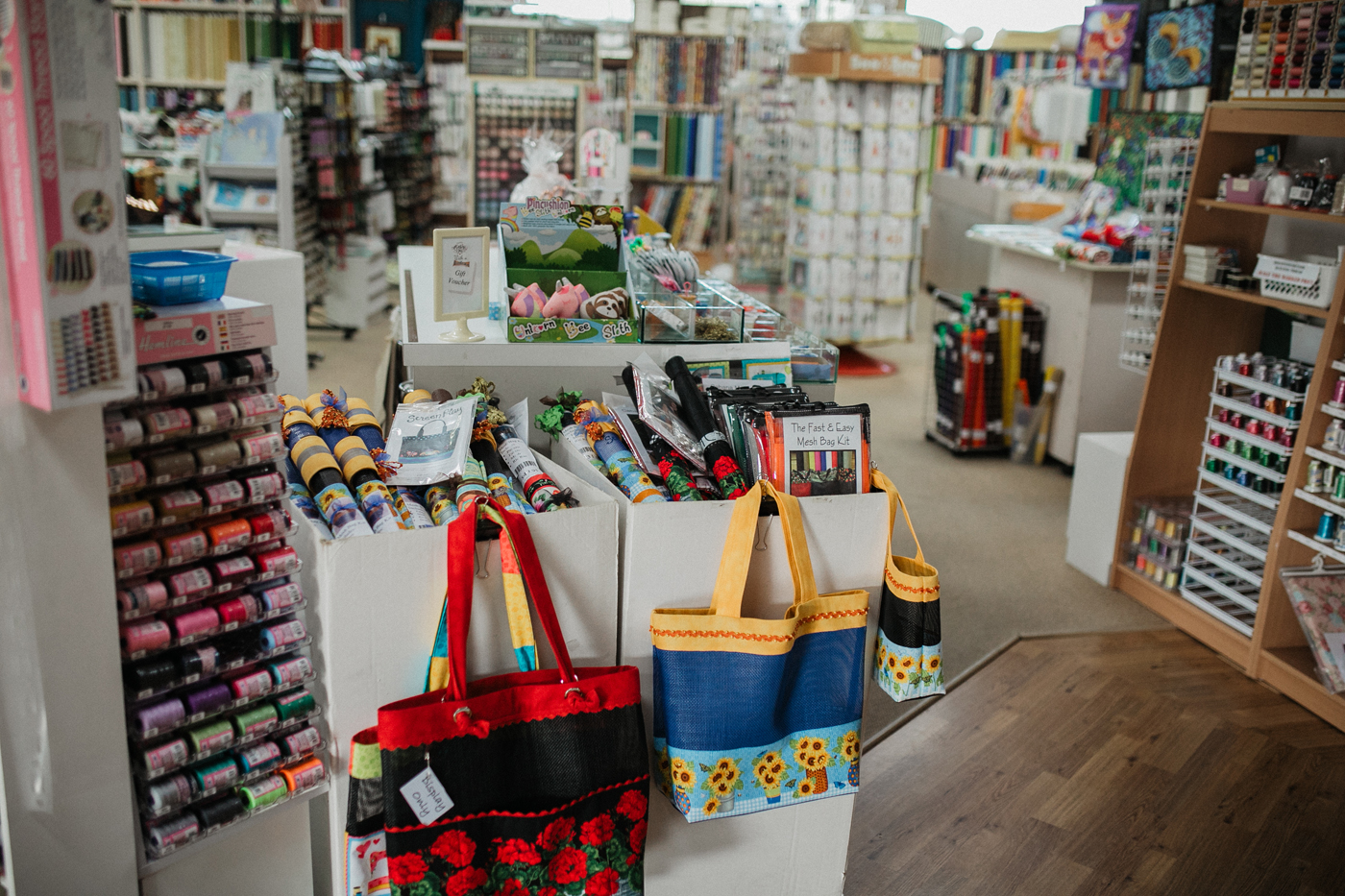 Needleworx store with rows of fabric and sewing material