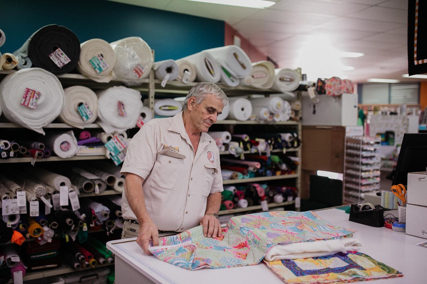 Needleworx team preparing quilt