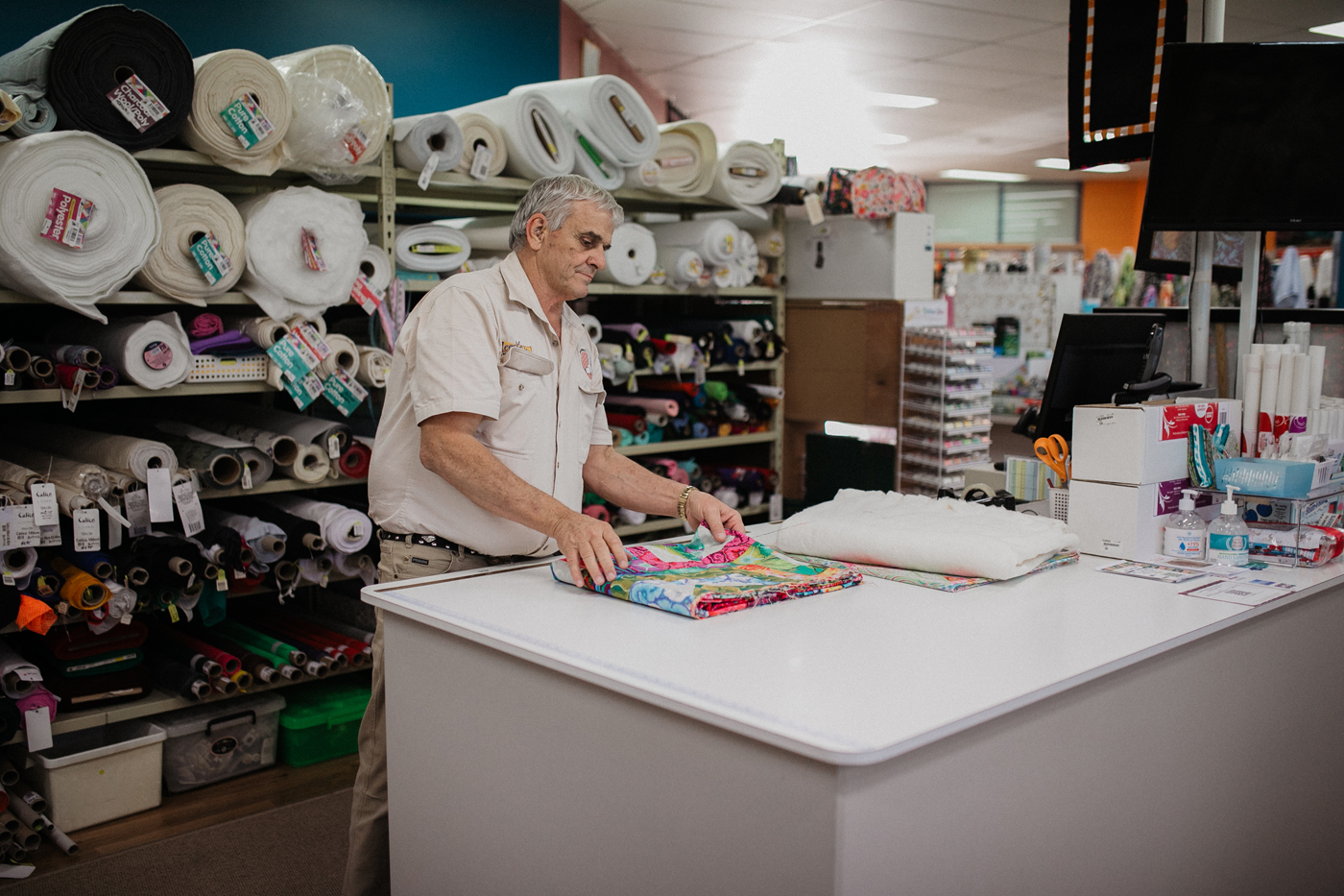 Needleworx team preparing quilt fabric