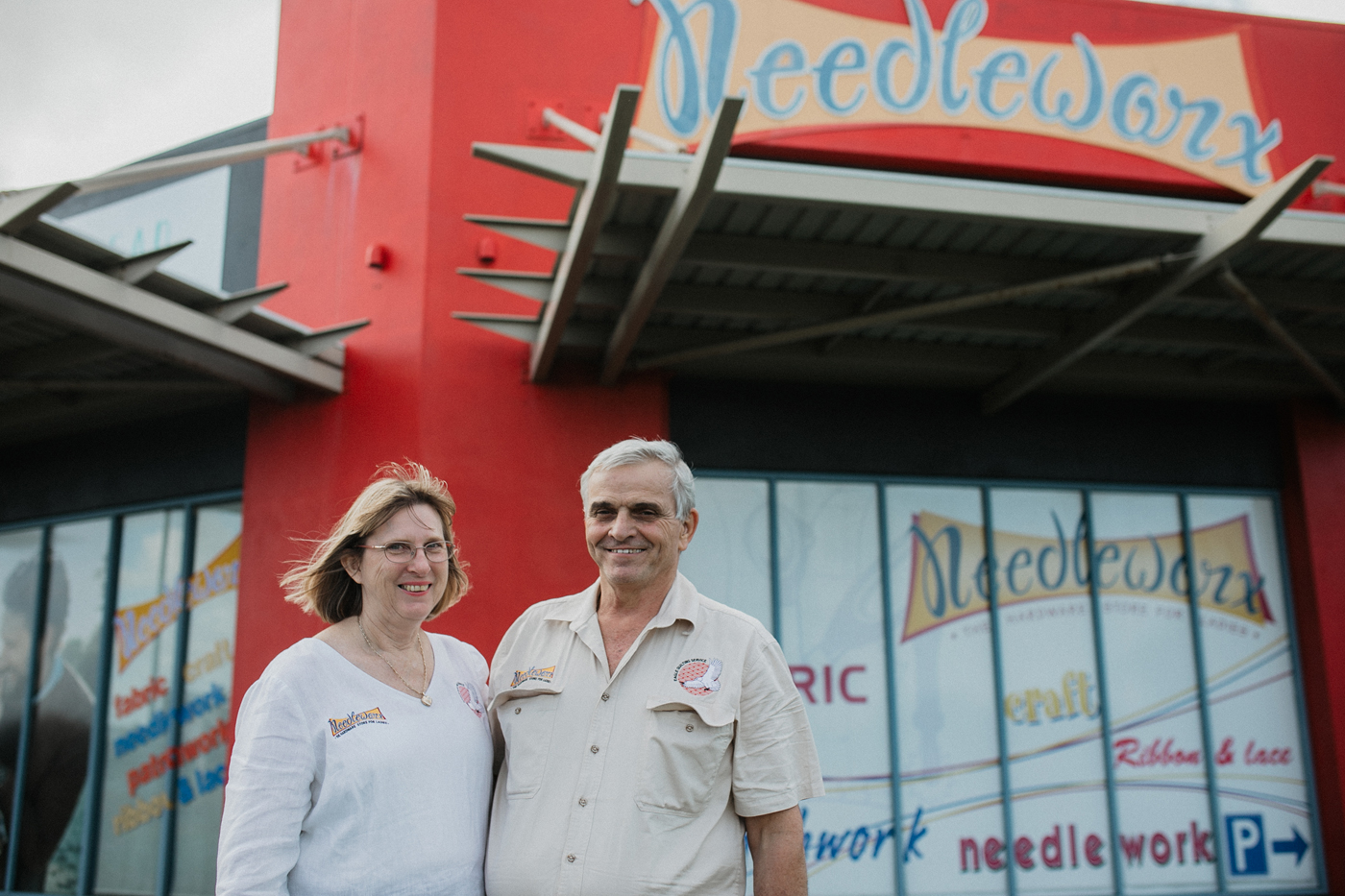Richard and Ann Giumelli in front of Needleworx store